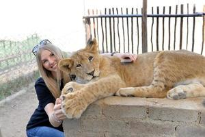 The girl and Lion cub, South Africa. March 31, 2015 photo