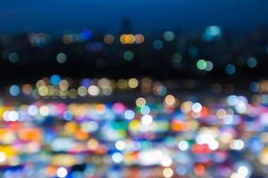 Blurred bokeh city lights background multiple colours photo