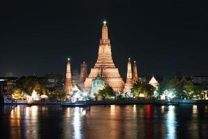 Glowing Wat Arun at night. photo