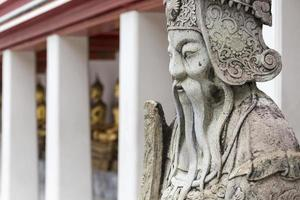 Statue of a Chinese warrior near an entrance