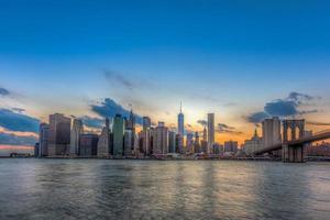 New York City Manhattan downtown skyline and Brooklyn bridge.