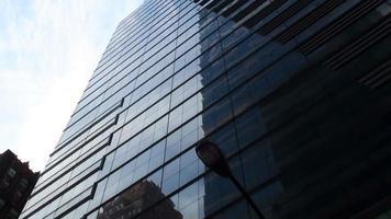 New York High Rise Glass Building Against Pure Blue Sky photo