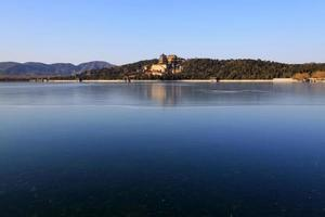 Tower of Buddhist incense and frozen Kunming lake photo