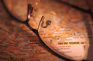 glasses on an map photo