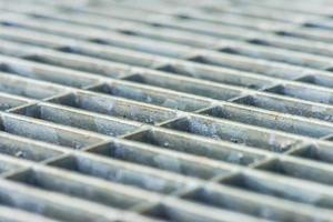 Metal grille in front of door