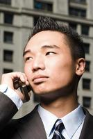 Young businessman on mobile phone