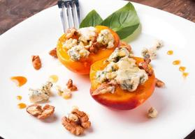 Roasted peaches with dorblu cheese photo