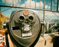Coin operated binoculars with vintage effect on Empire State Bui