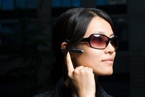 Woman using headset photo