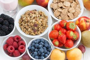 fresh berries, fruit and muesli, top view