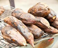 Grilled sweet potatoes at the market in Vietnam.