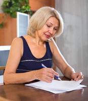 Portrait of woman with documents photo