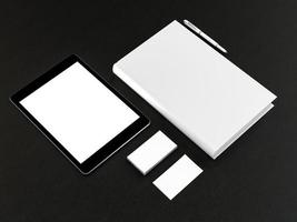 layout white papers and business cards with the tablet