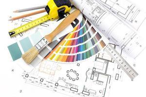 Architect's work tools on blueprints background photo