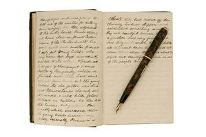 Pages in an antique travel diary with fountain pen