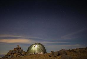 Tourist stand near tent photo