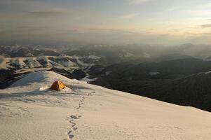 Camping during winter hiking in Carpathian mountains photo