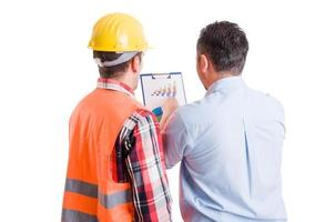 Business developer and contractor builder discussing charts