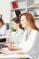 Teamwork at modern graphic design studio photo