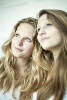 Teenage girls smiling together