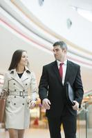Businessman and businesswoman walking together