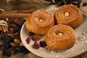 Turkish Ramadan sweet - Sekerpare with wooden background