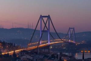 Bosphorus Bridge and traffic in the morning photo