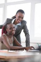 Businesswomen working together in an office photo