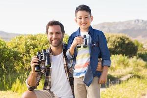 Father and son on a hike together photo