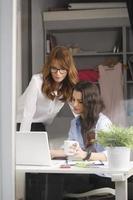 Beautiful fashion designers working together
