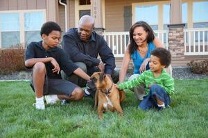 Family petting dog photo