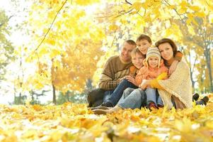 Happy family in autumn forest photo