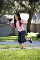 Asian child playing hopscotch