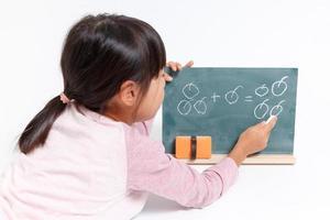 Child who studies the arithmetic photo