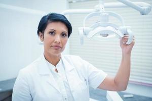 Confident female dentist