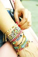 Stylish bracelets on female hand photo