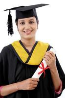 Happy young female student holding diploma photo