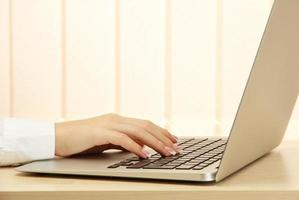 female hand writing on  laptot, close up photo
