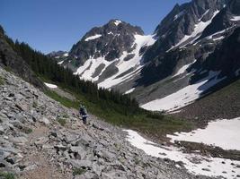 Female Backpackers Crossing a Boulder Field