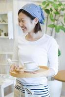 Female cafe staff carrying coffee photo
