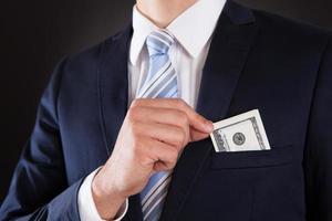 homme affaires, mettre, argent, poche