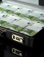 Briefcase with money photo