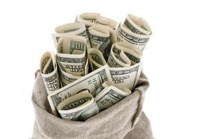 u.s. dollars bills in a sack