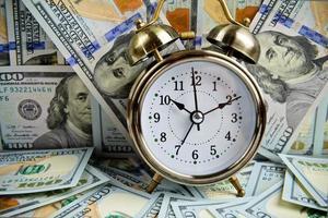 alarm clock over money photo