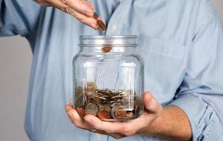 Saving Money In Jar photo