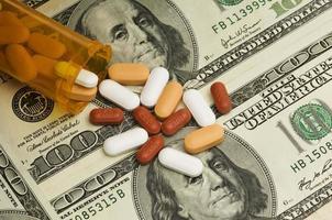 Pills spilled over money photo