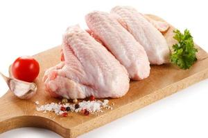 Raw chicken wings on cutting board