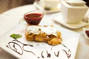 Pear and raisins strudel with berry sauce photo