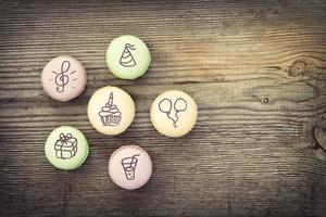 French macarons on  old wooden background photo