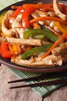 Chinese food: chicken with vegetables closeup vertical photo